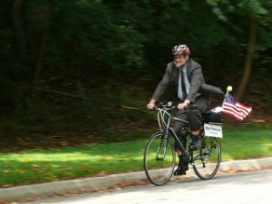 Mark rides his bike to a Mayor and Council meeting.